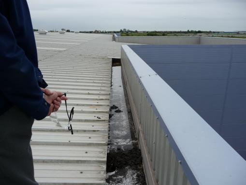 Leaking factory metal box gutter baglan industrial estate for Leaking roof gutter
